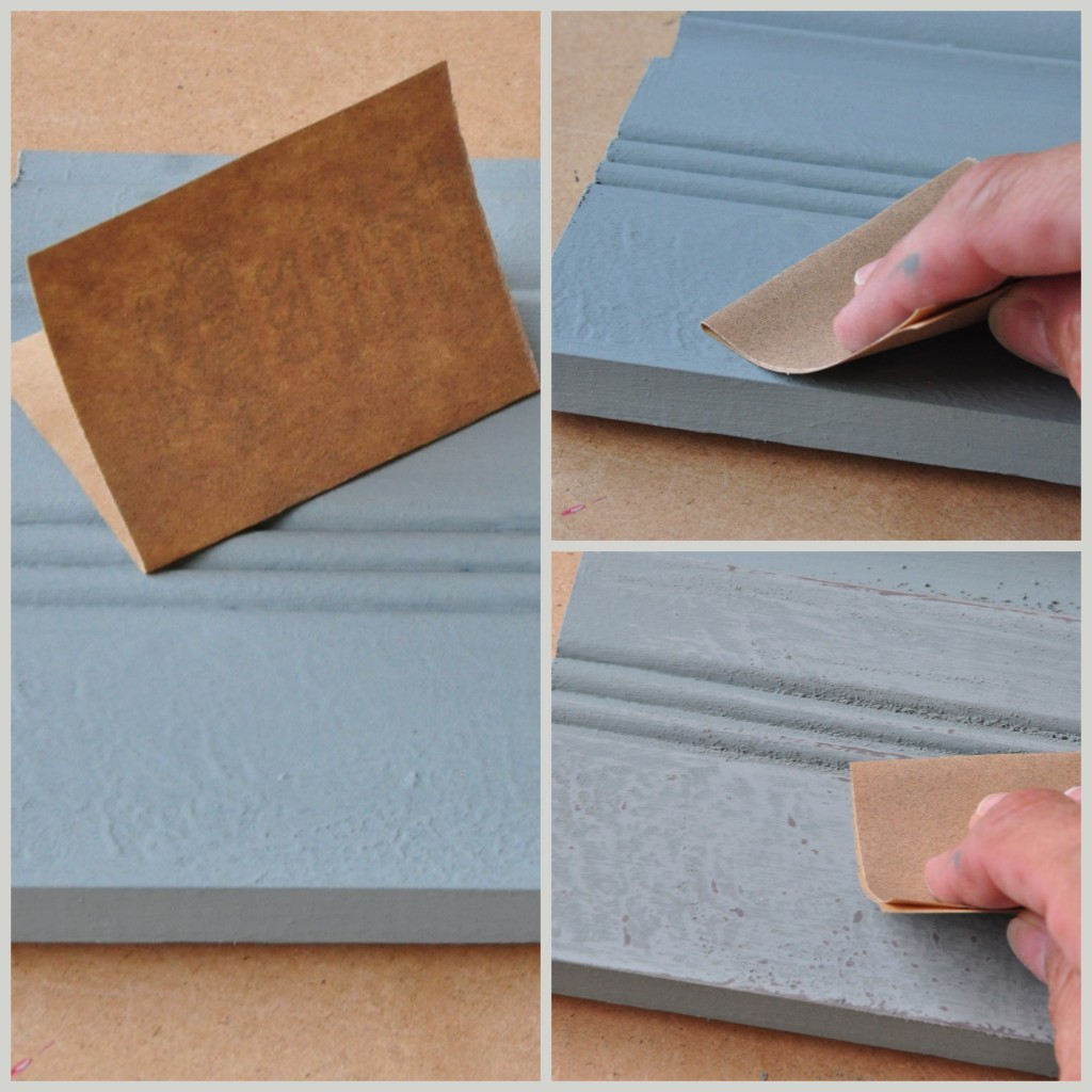 Distressing the textured finish using a fine grit piece of sandpaper.