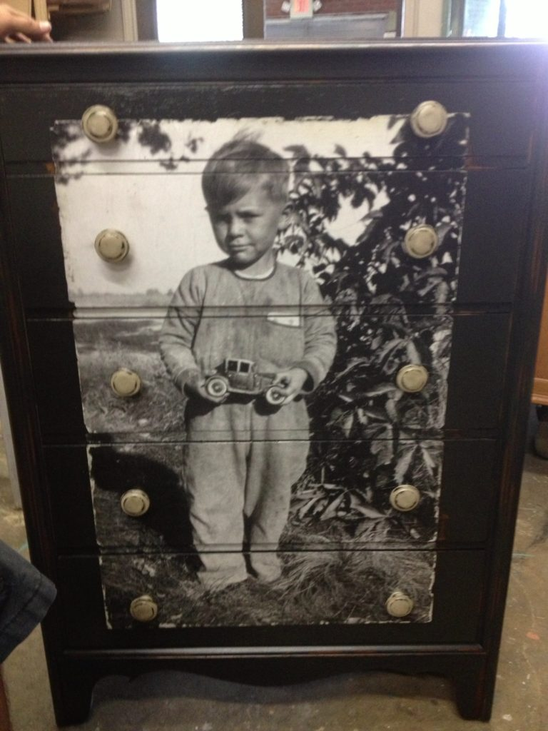 decoupaged dresser with little boy