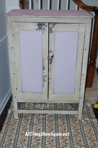 antique cabinet before shot