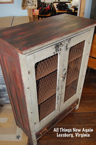 11. Rooster Cabinet