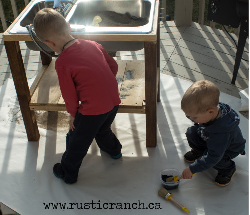 Sand table painting helpers!